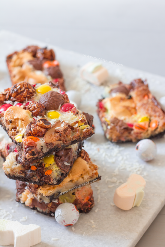 Candy Overload Magic Bars | Annie's Noms - An Oreo base is topped with condensed milk, shredded coconut and a myriad of candy creating a soft gooey, chocolatey magic bar!