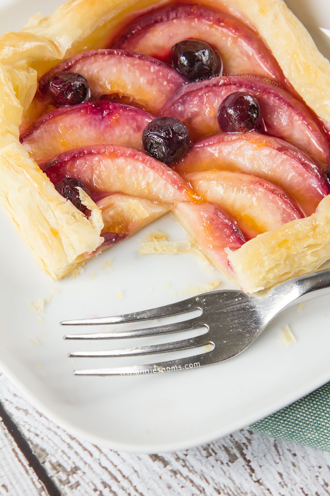 My simple Peach and Blueberry Mini Tarts are so easy to make, yet bursting at the seams with sweet fruit. Shop bought puff pastry is layered with sliced peaches and fresh blueberries before being baked until golden. The perfect Summer dessert!
