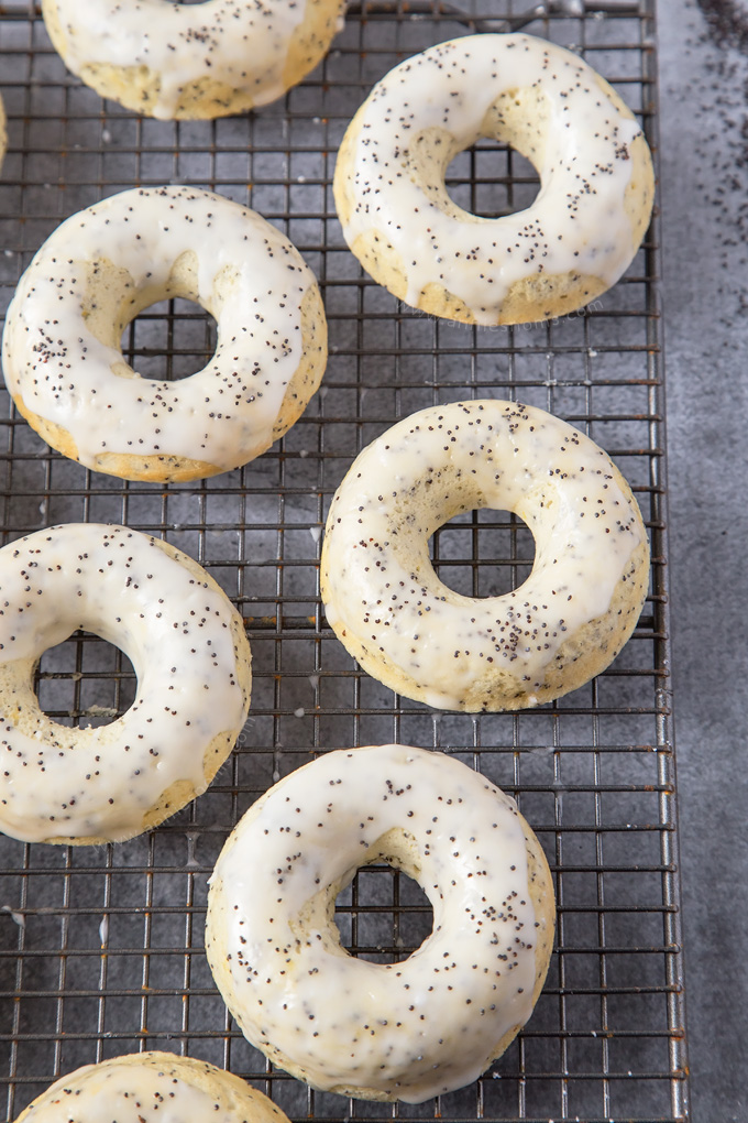 These baked Lemon Poppy Seed Doughnuts are light, crunchy and filled with lemony goodness! An easy, super tasty Spring bake everyone will love!